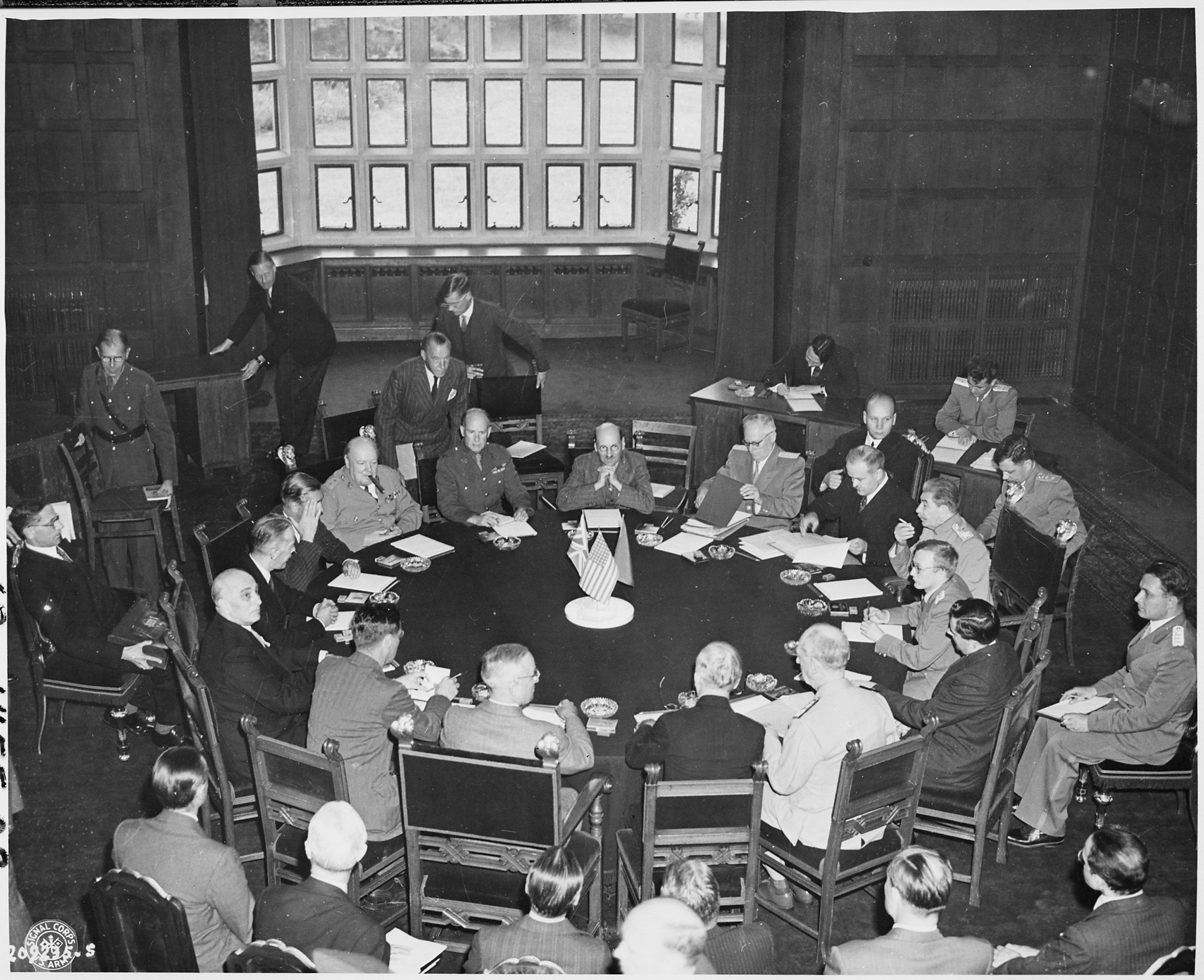 Opening_session_of_the_Potsdam_Conference_in_Potsdam,_Germany._President_Harry_S._Truman_is_seated_foreground_(back..._-_NARA_-_198799